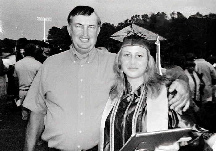Chana Clark with her Dad at Graduation