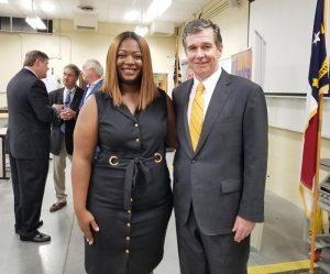 Emergency Grant recipient, Erica Ways with Governor Cooper