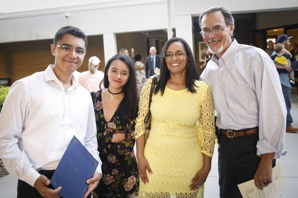 Student after 2019 Honors Convocation Award ceremony with family.