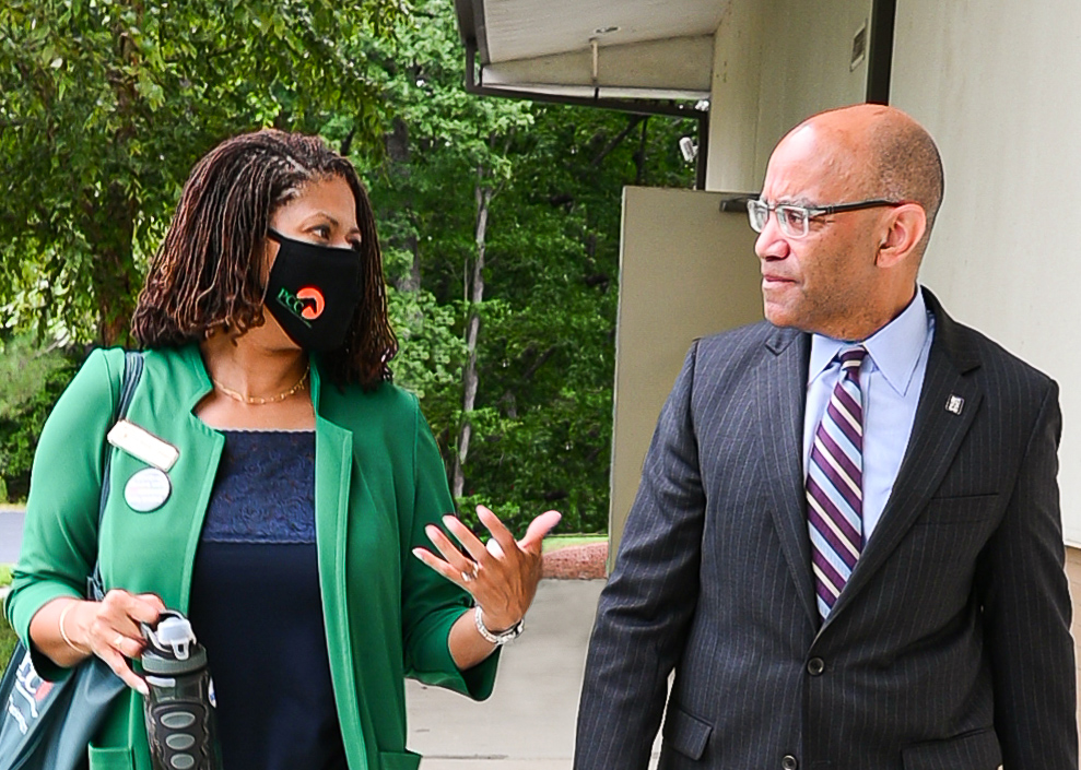 Dr. Pamela Senegal on the left is speaking with President Thomas Stith III while walking on the sidewalk